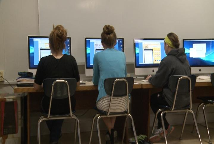 Liberty High School students learning finance with the Banzai program.