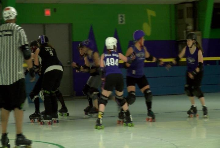 The Dark River Derby Coalition prepare for their bout on Saturday. A portion of ticket sales goes towards Quincy's Teen REACH.