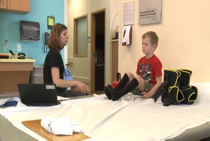 Eight-year-old Colton, a patient at the Shriners Hospitals for Children, goes through physical therapy for clubbed feet.