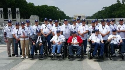 Veterans pause for a group photo Thursday.