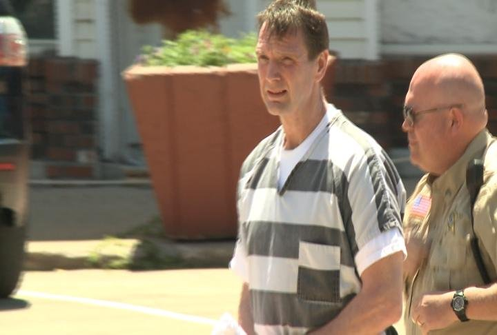 Curtis Lovelace escorted into the Cass County Courthouse on Monday.