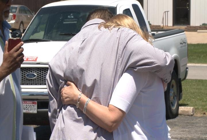 Curtis Lovelace hugs his wife, Christine, after being released from the Hancock Co. Jail Thursday.
