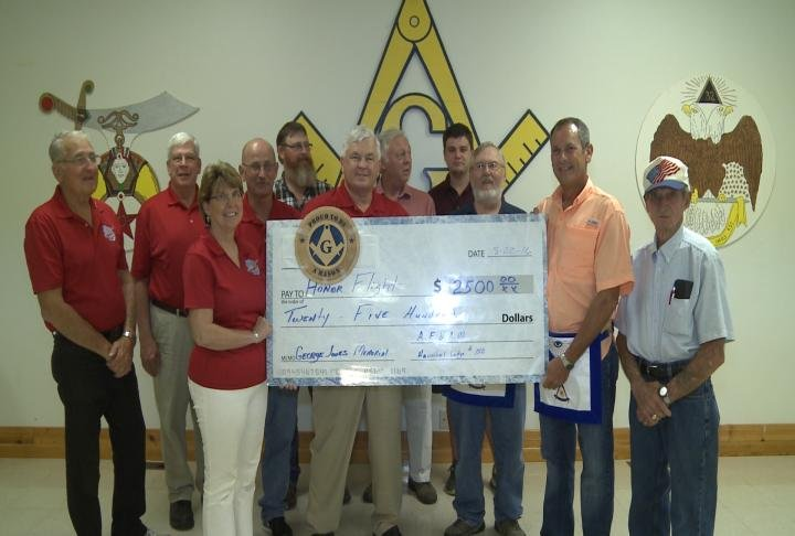 Hannibal Masonic Lodge #188 presents a check to Great River Honor Flight for $2500 in memory of fellow member George Jones.