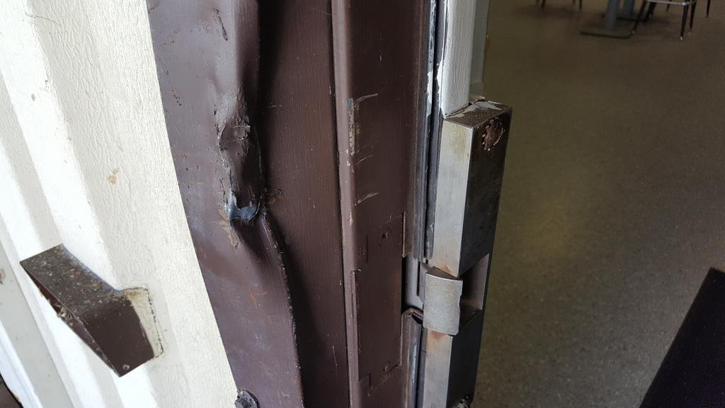 Damage on one of the doors at South Side Boat Club.