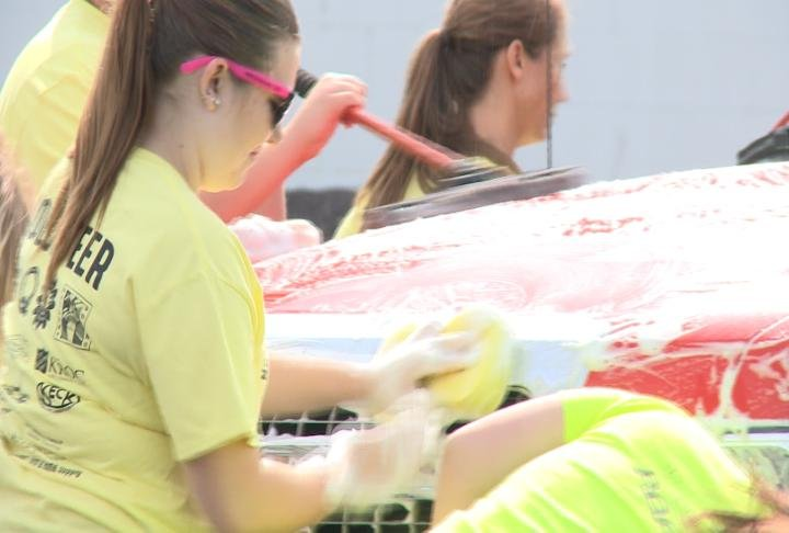 Students washed cars to raise money and awareness for mental health programs.