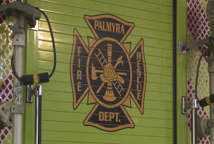 Palmyra Fire Department logo on the back of a truck. Officials say the department is struggling with funds.