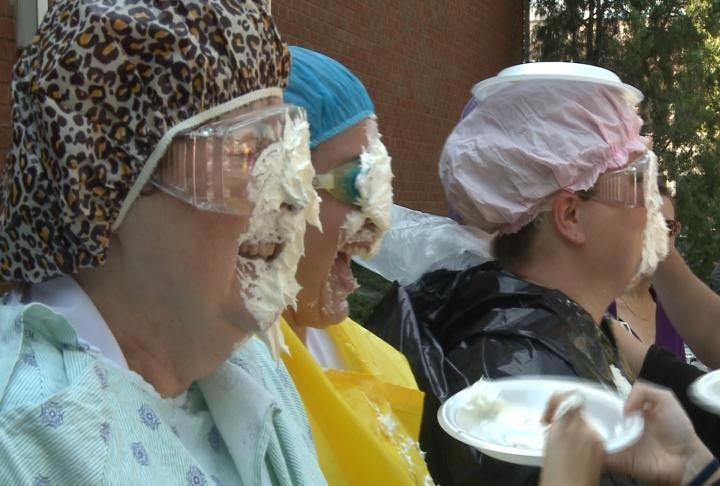 Faculty and administrators had their faces covered in whipped cream