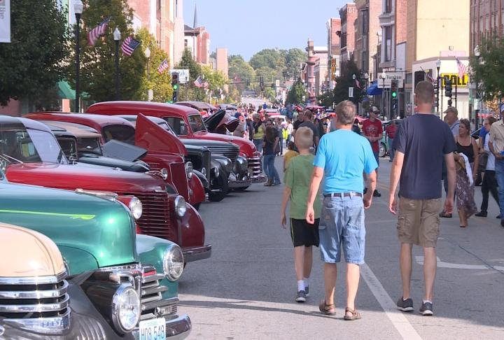 Hundreds of people walked the streets looking at the different cars on display.