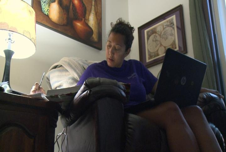 Dickerson working on her online schooling from home.