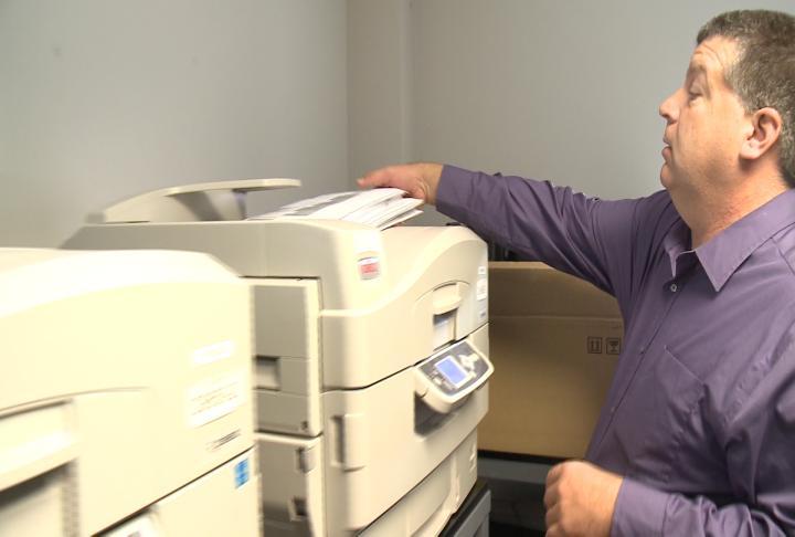Adams County Clerk Chuck Venvertloh prints ballots aheads of the November 8th election
