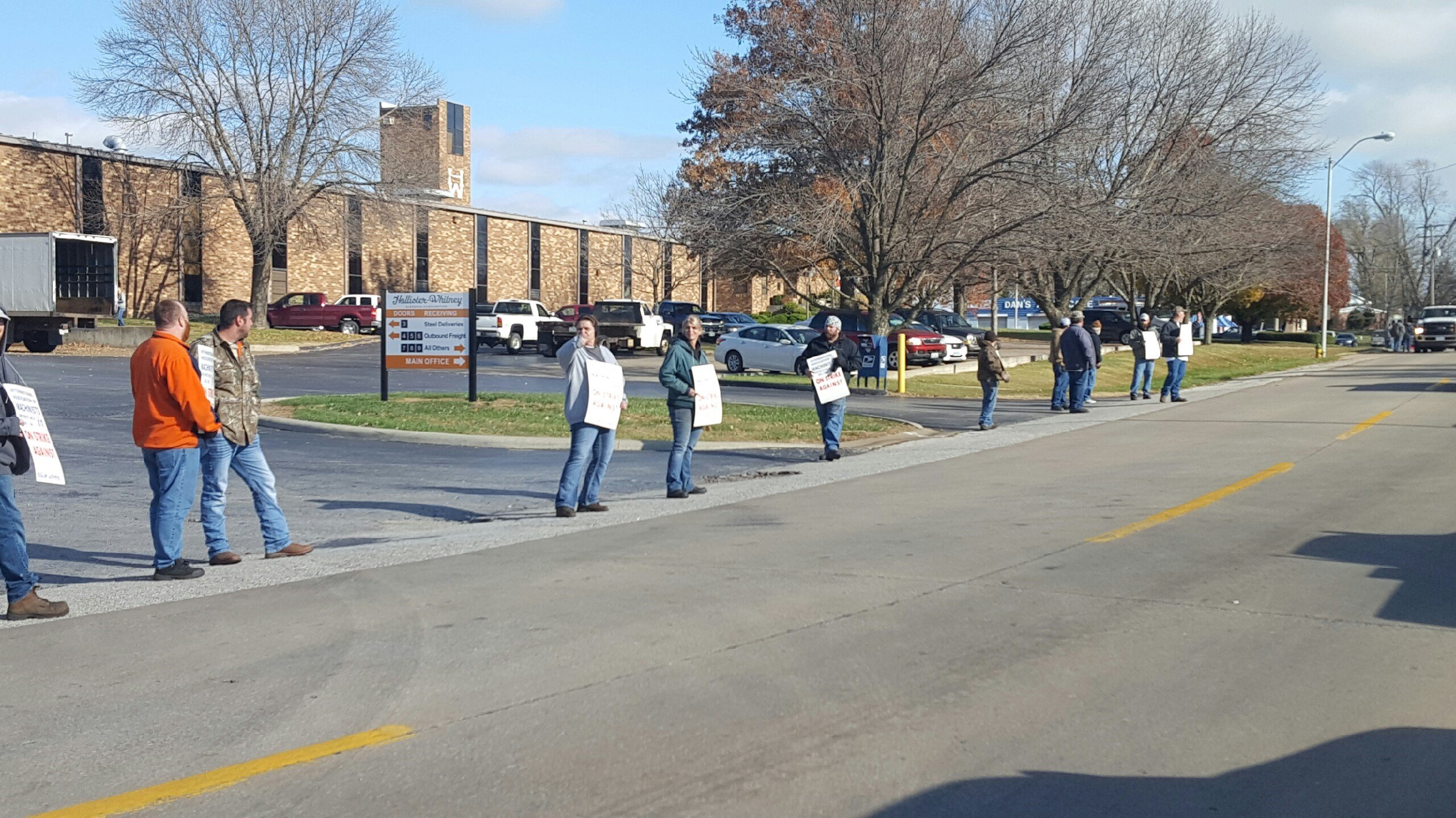 Hollister Whitney employees picket outside of the Facility.