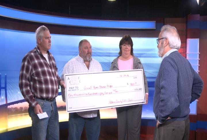 Adams County Folks Care Program presented a check for Honor Flight Monday
