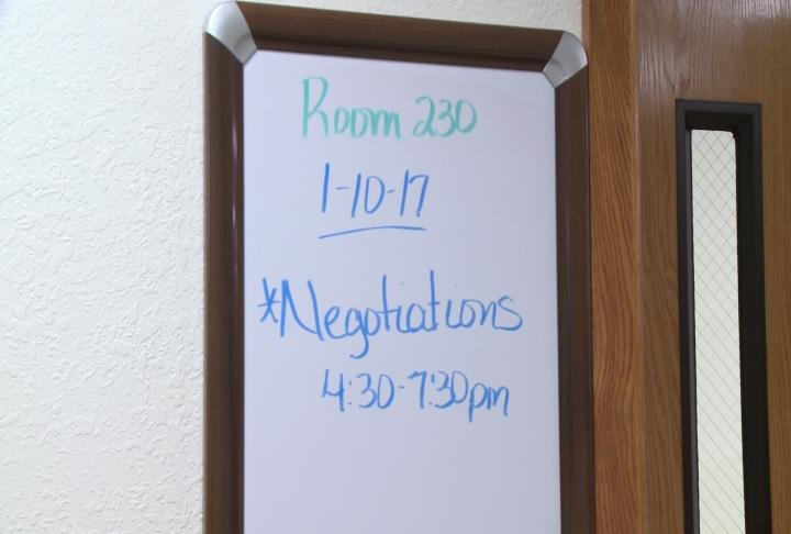 A sign hung up showing the proposed time for contract negotiations