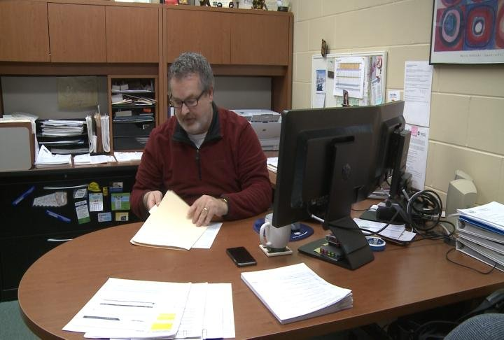 Bill Stalder working in his office at Adams Electric Cooperative