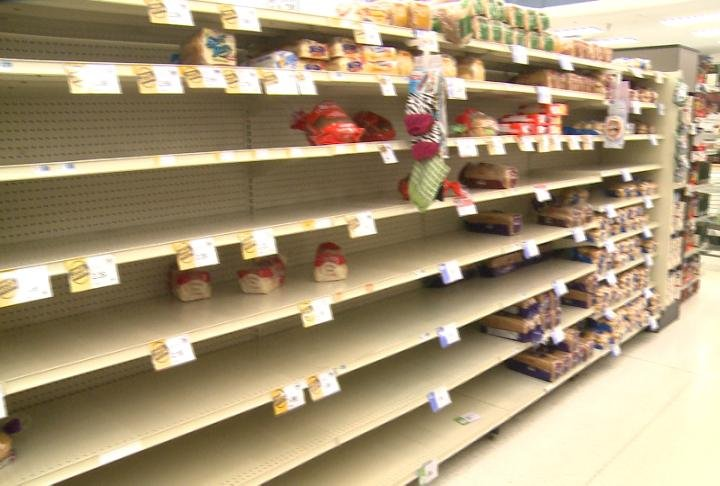 Shelves sat empty as residents shopped ahead of the ice storm.