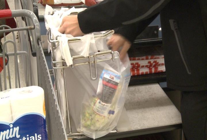 Cashier puts items in the bag.