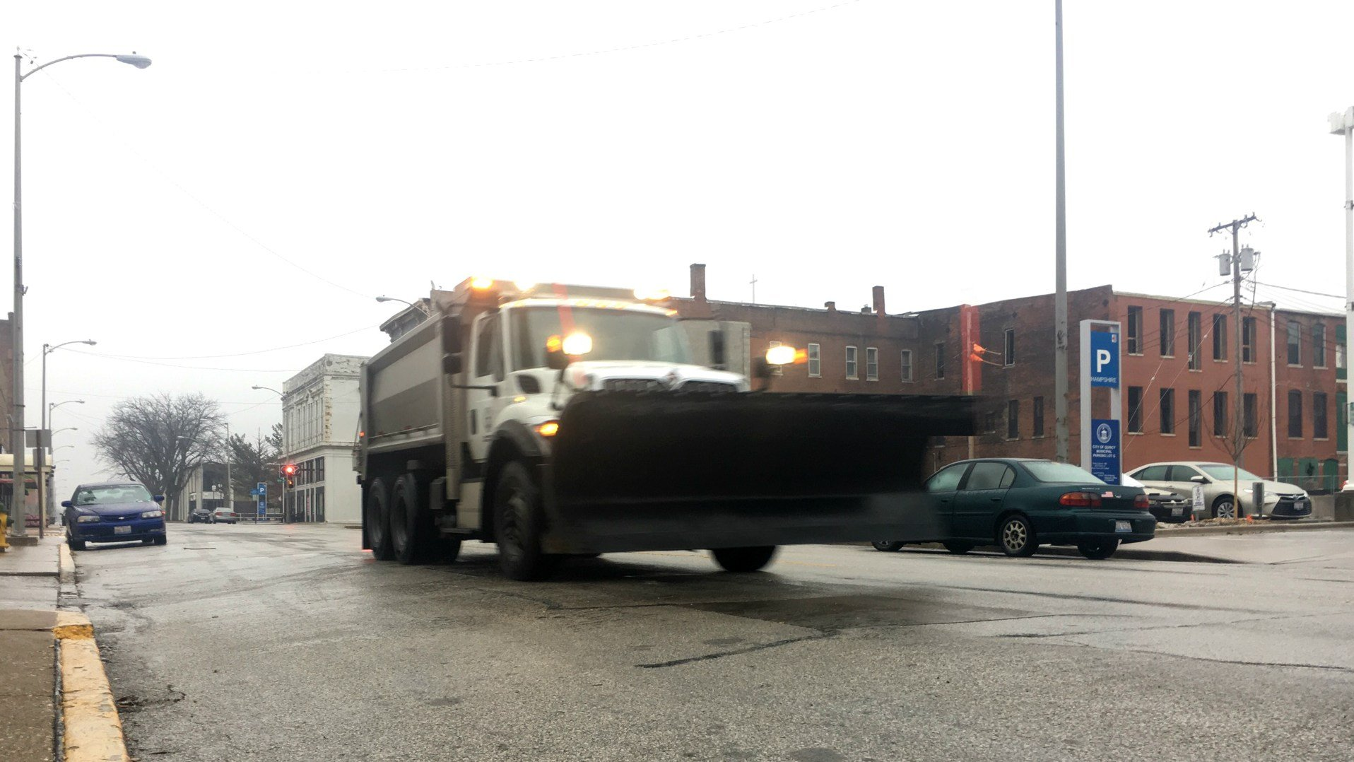 Roads crews in downtown Quincy.