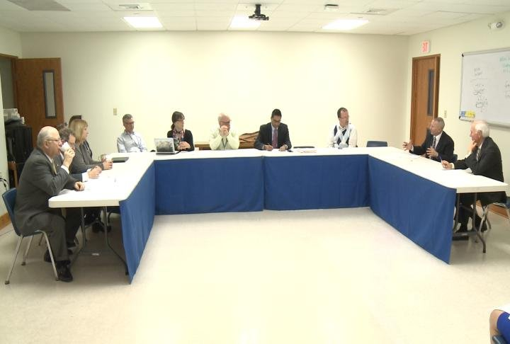 Memeber of the board and union at QPS meet to ratify contract and unite unions. The contract is set to expire June 30th.