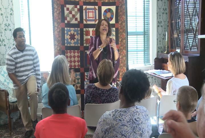 Mett Morris leads visitors in song