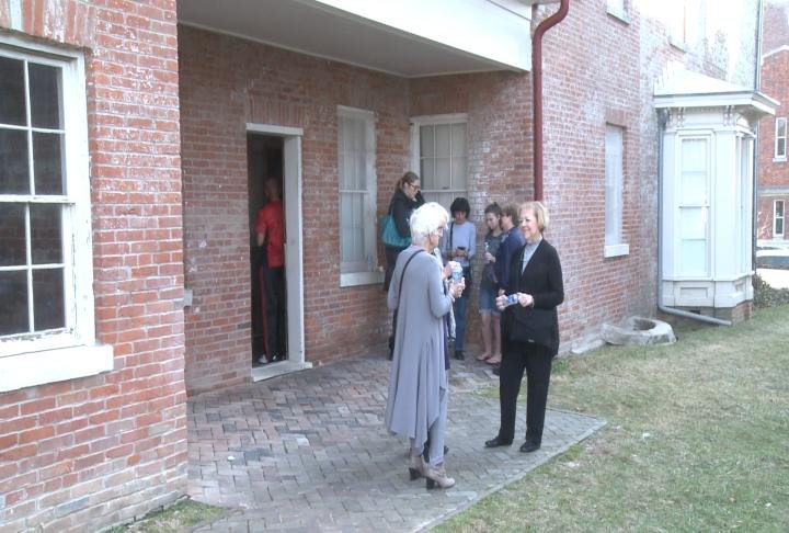 Visitors enjoy the weather outside of Dr. Richard Eells' house