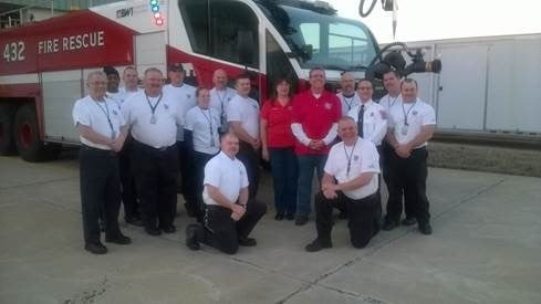 Board members Doug Reed and Annette Hoskins with members of the BWI team.