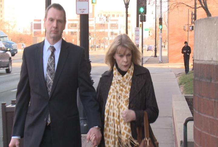 Curtis Lovelace and his wife Christine arrive at the Sangamon County Courthouse in Springfield.