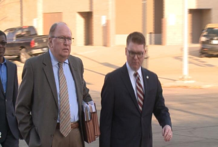 Special Prosecutor Ed parkinson (left) arrives at the courthouse Monday morning.