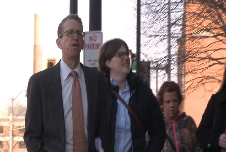 Lovelace's defense attorney Jon Loevy (left) arrives at the courthouse.