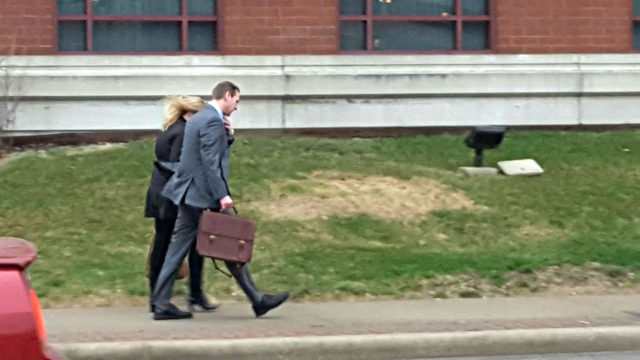 Curtis Lovelace and his wife Christine arrive at the courthouse Tuesday morning.