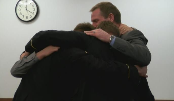 Curtis Lovelace hugs family members after the not guilty verdict.
