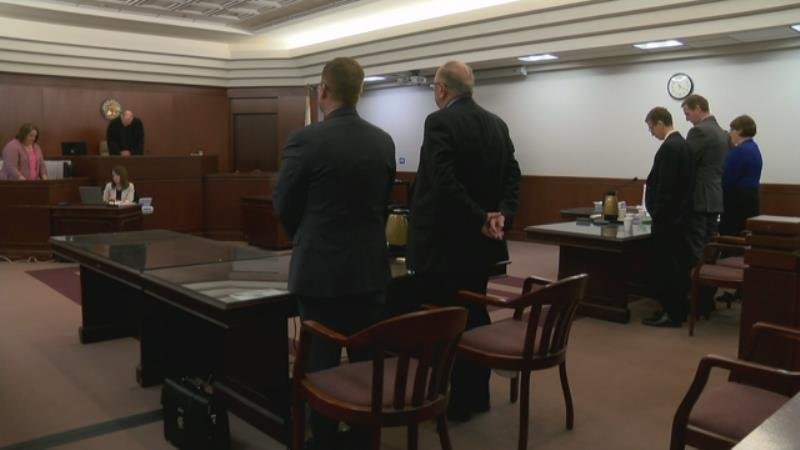 Attorneys and Curtis Lovelace stand up before the verdict was read.