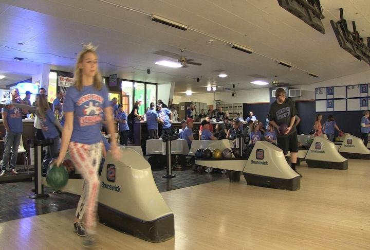 Bowling teams playing games which raised money for local veteran programs.