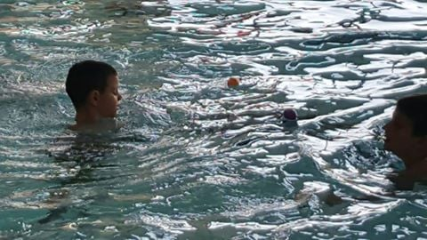 Kids hunt for Easter eggs in the pool at Quincy's YMCA