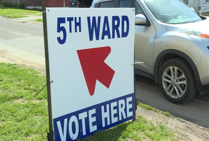 Posters point voters to 5th ward election.