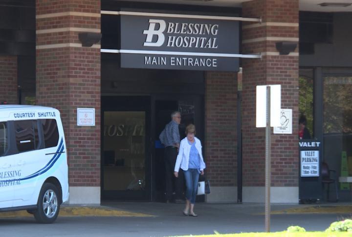 A resident leaves Blessing Hospital.