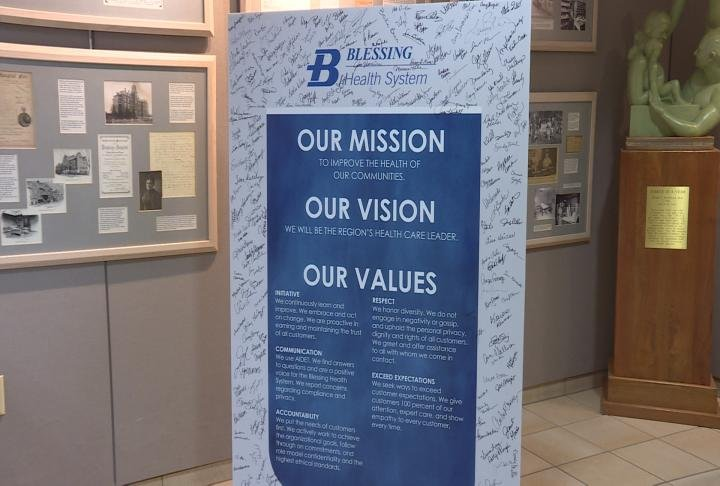 A sign displays Blessing Hospital mission statement.