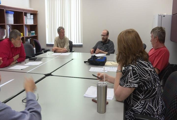 Adams County Board Members discuss creating a new position.
