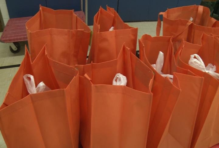 The bags are placed in the students' lockers every Friday.