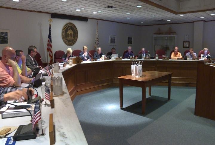 Quincy City Council prepare for meeting to start.