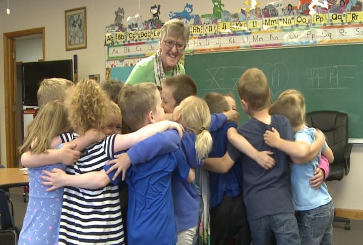 Students hugging Mrs. Powell