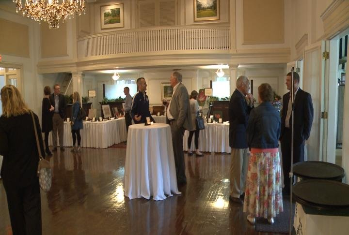 Attendees talk during Hope for Horizons fundraiser.