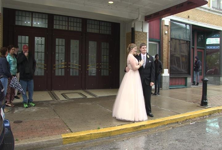Two students taking their prom pictures outside.