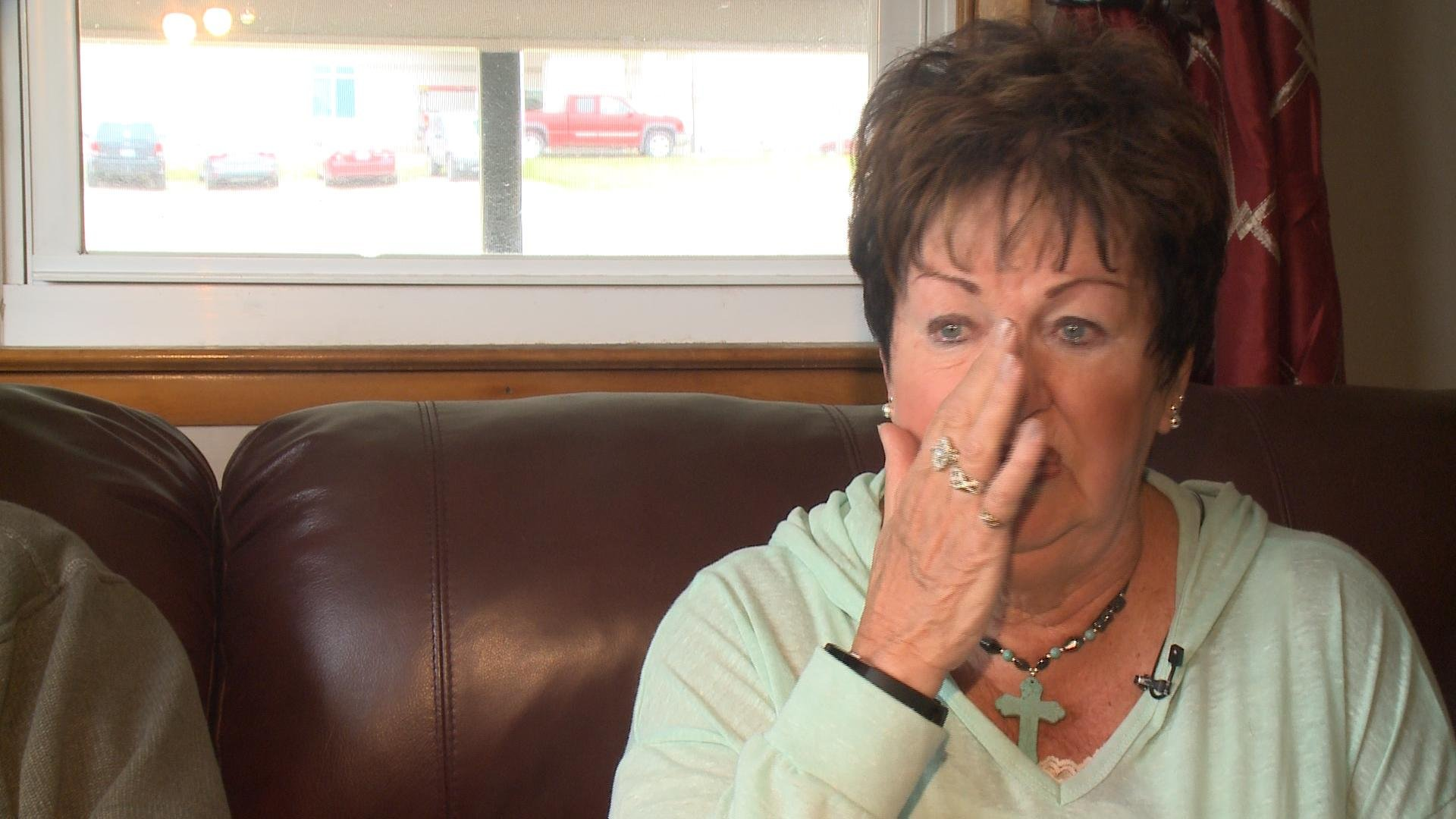 Pauline Lorenz wipes a tear from her eye as she talks about losing her son Rick in a boating accident in July 2016.
