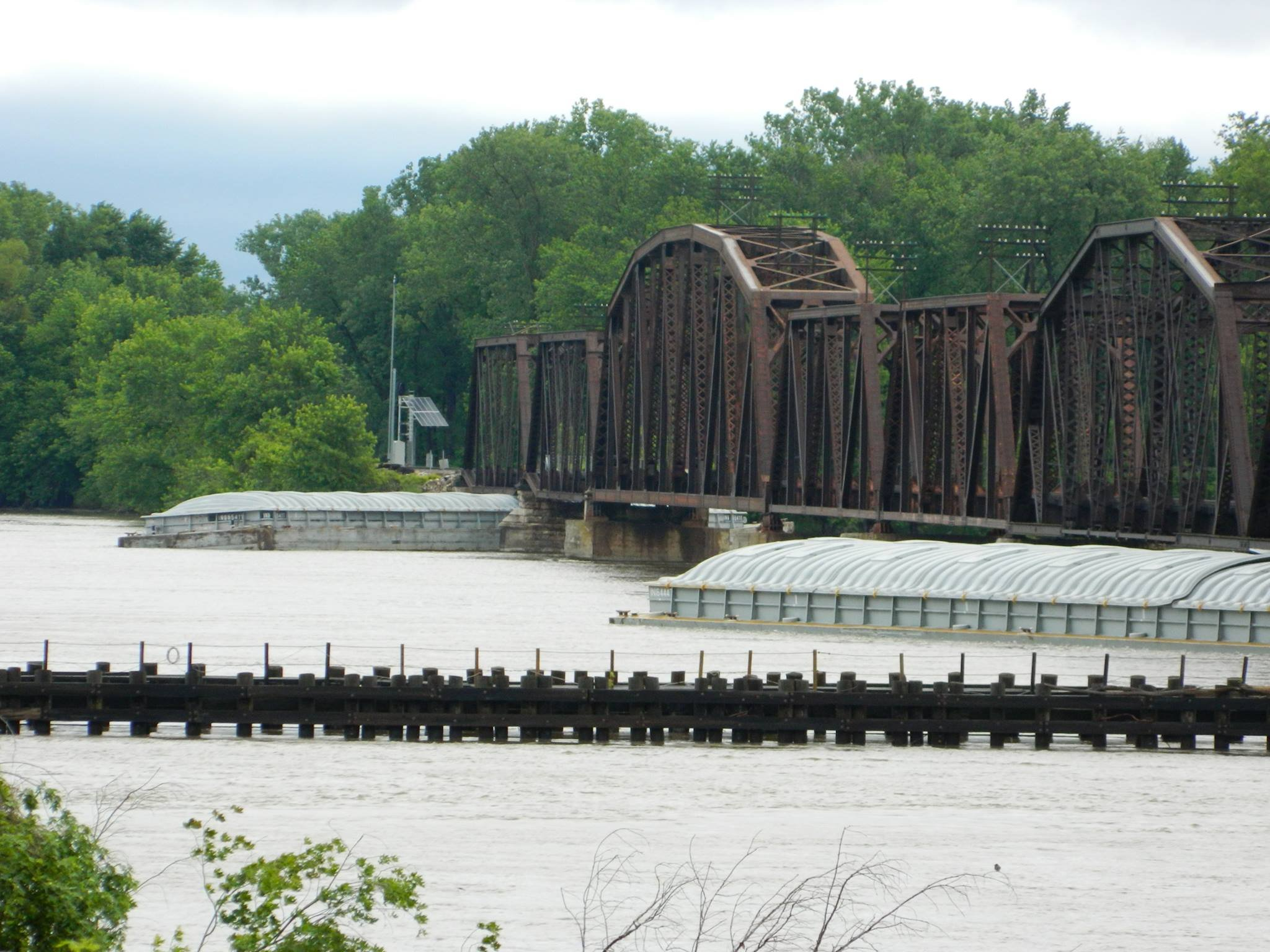 Submitted photo of barges stuck on the rail bridge south of the Champ Clark Bridge.