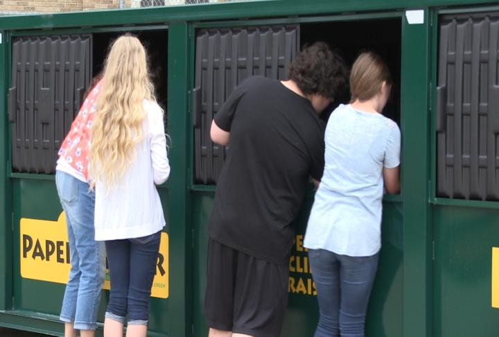 Each time the bin is emptied, the junior high will earn money