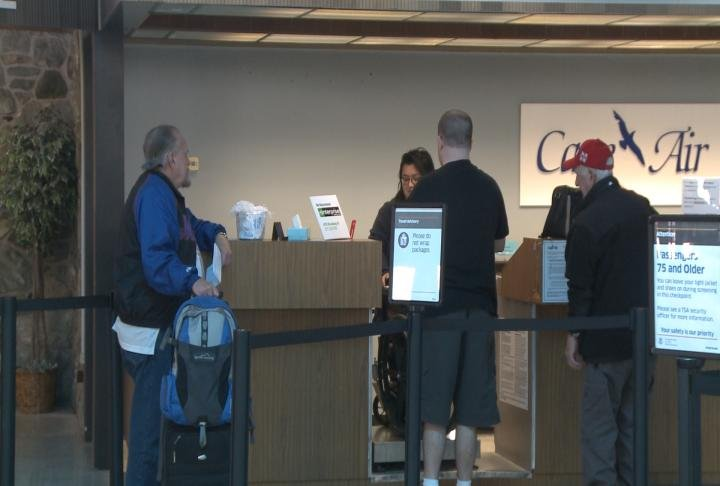 Passengers prepare to check in for a flight on Cape Air.