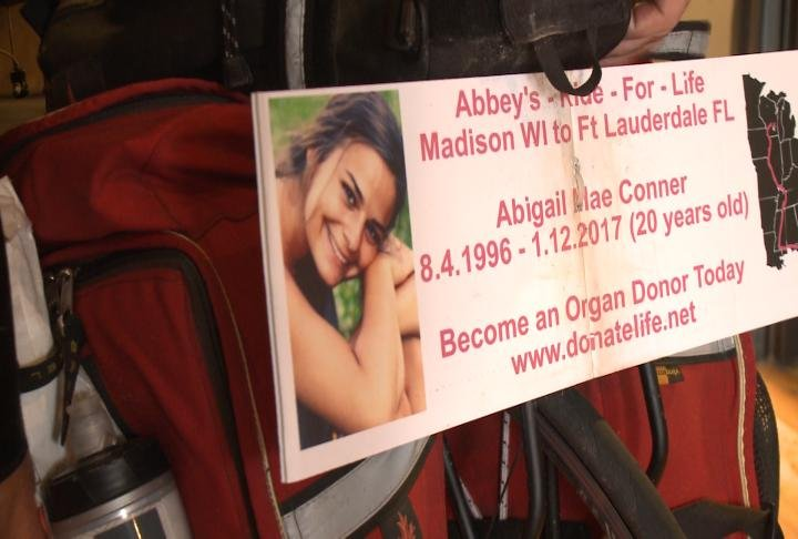 Sign on the back of Bill Conner's bike showing what his ride is for.