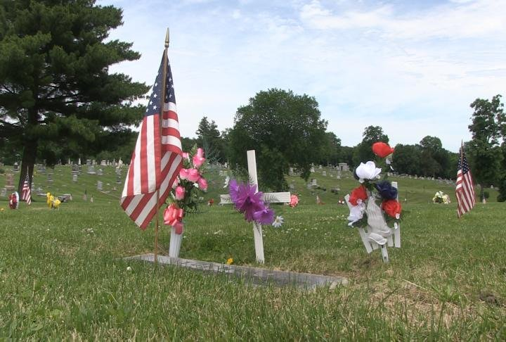 Clay raised flags all around the cemetery.