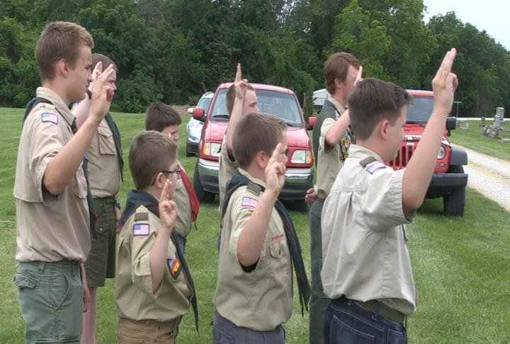 Other eagle scouts taking in the ceremony and work.