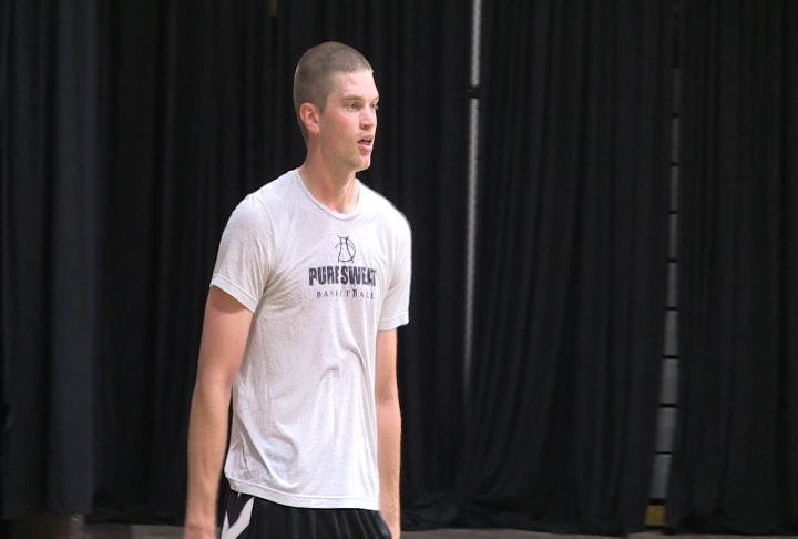 Former Quincy University and Illini West star Evan McGaughey is spending countless hours in the gymnasium in preparation for a professional career.